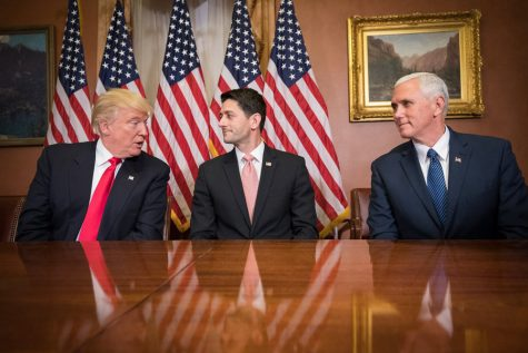 President Trump chats with Speaker of the House Paul Ryan and Vice President Mike Pence. Both men were present for Trump
