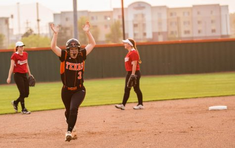 Freshman Bailey Groom runs to third base with excitement after hitting her very first home run. The Lady Tigers battled it out against Greenville's Lady Lions on March 28, 2017.