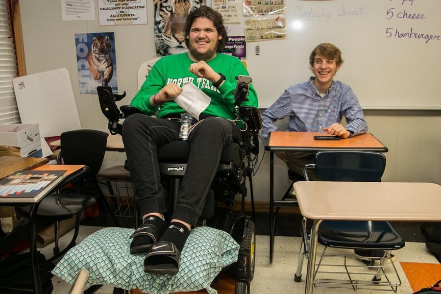 Senior Mayten Lumpkin laughs with senior Matt Wells during class. Lumpkin's first day back was Feb. 27.