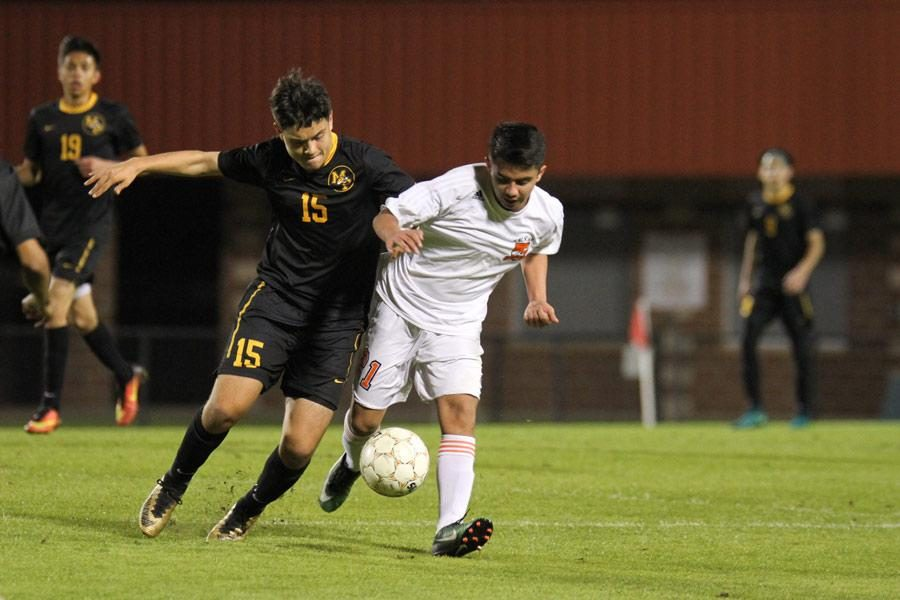 Sophomore Juan Lebrata struggles with a Mount Pleasant player for control of the ball. The Tigers suffered a 3-0 loss to Mount Pleasant  on March 3.
