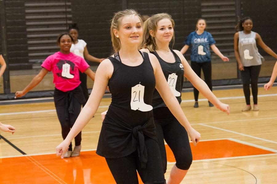 Freshman Margaret Debenport performs in front of the judges during tryouts. This year, girls who have been on the team for three years were not required to try out.