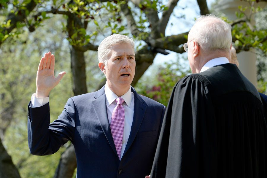 Justice Anthony Kennedy swears in Neil Gorsuch as an Associate Justice of the Supreme Court during a ceremony at the White House Rose Garden April 10, 2017 in Washington, D.C.