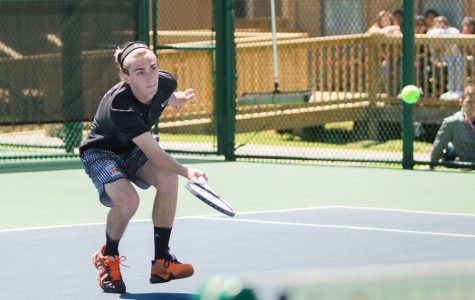 Sophomore Grant Rommel lunges for the ball during the last match of the district tennis tournament. The tournament took place on April 5-6 at Texas High.