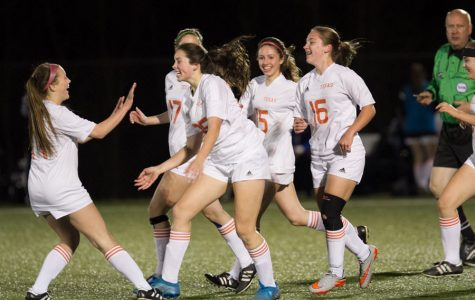 Sophomore Sarah Jane Paddock and junior Jillian Ross celebrate after a 5-2 victory against Greenville on March 7. The girls soccer season ended March 24 after a loss in playoffs.