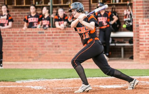 Sophomore Kaitlyn Cross exits the batters box after a base hit in the third inning in the Lady Tigers game against Greenville March 31, 2017. Texas High defeated Greenville 10 - 0.