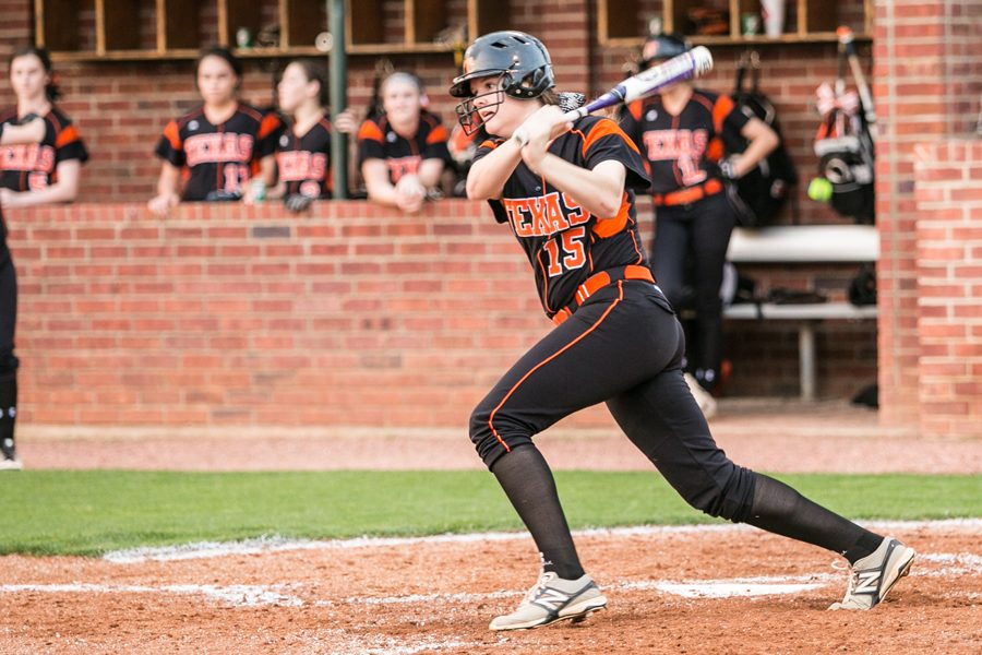Sophomore+Kaitlyn+Cross+exits+the+batters+box+after+a+base+hit+in+the+third+inning+in+the+Lady+Tigers+game+against+Greenville+March+31%2C+2017.+Texas+High+defeated+Greenville+10+-+0.