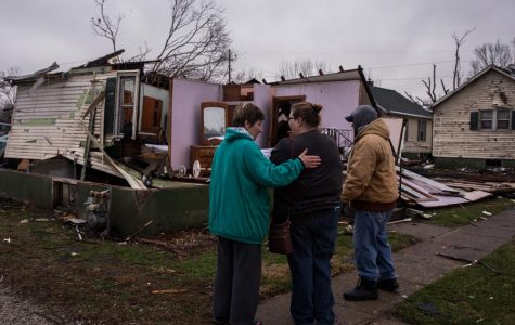 Resident Nancy Warner, center, gets a hug from Sherry Pagakis as she surveys tornado damage to her house on Wednesday, March 1, 2017 in Naplate, Ill. Neighbor Kip Frazier is on the right. Photo by Zbigniew Bzdak