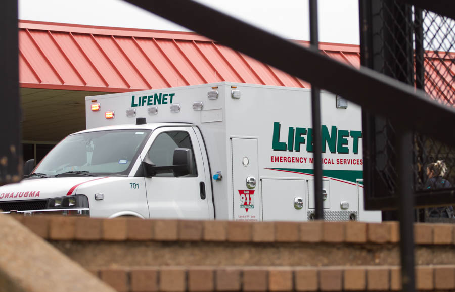 A LifeNet ambulance sits on the Texas High School campus Aug. 29, 2017. A student suffered a hand amputation in the Sullivan Performing Arts Center.