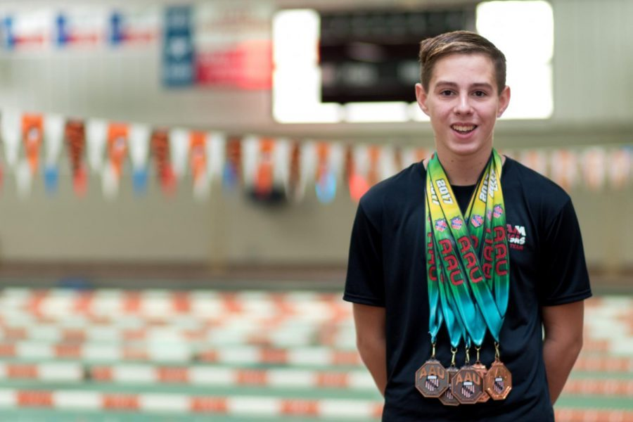 Freshman John David Cass swims competitively, not only on the Tigershark team, but nationally as well.