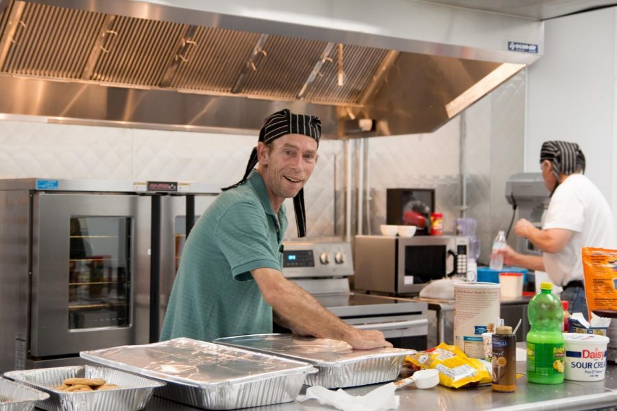 Workers at the Randy Sams homeless shelter cook and prepare food for those in need.