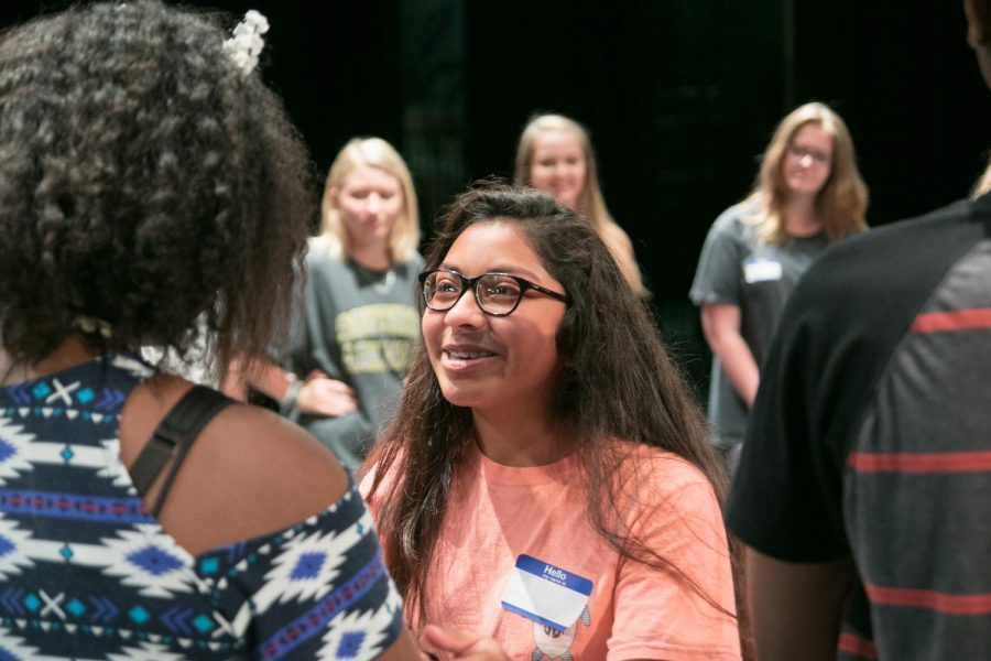 Students enthusiastically greet one another during the first Tiger Theatre Company camp.