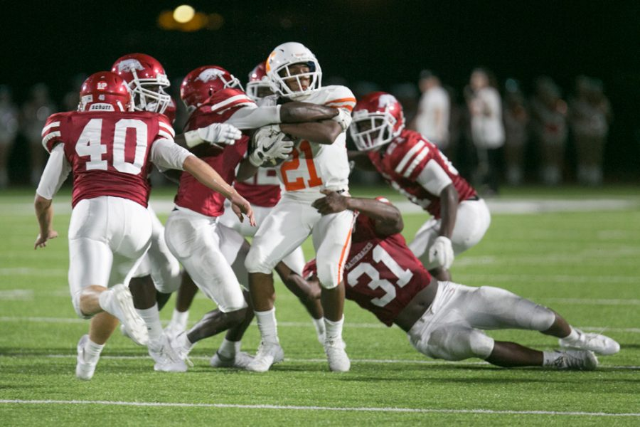 Texas High's Chris Sutton struggles to gain yardage against a host of Arkansas High Defenders. The Tigers lost to the Razobacks 7-0.