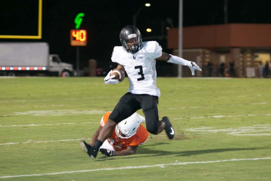 Bishop Lynch's Jarek Broussard rounds the corner against the Tigers on Sept. 1, 2017 at Grimm Stadium in Texarkana, Texas. The Friars capitalized on numerous Texas High turnovers to defeat the Tigers 24-7.