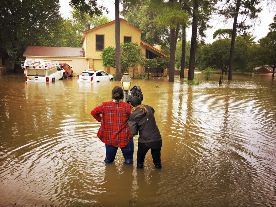 Journalist Morgan Walker and her partner stand in murky waters after Hurricane Harvey in Houston, Texas. Submitted  photo