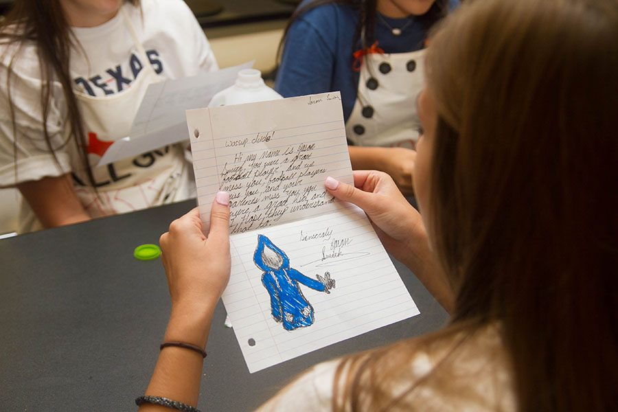 Students read their letters of encouragement given to them by various organizations on campus.
