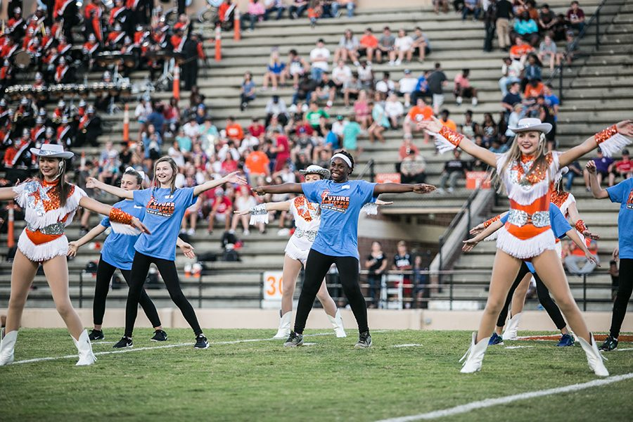 Future Highsteppers perform during pregame at the Texas High versus Liberty Eylau varsity football game. Participants learned their routine at the Future Highstepper Clinic the week before the game.