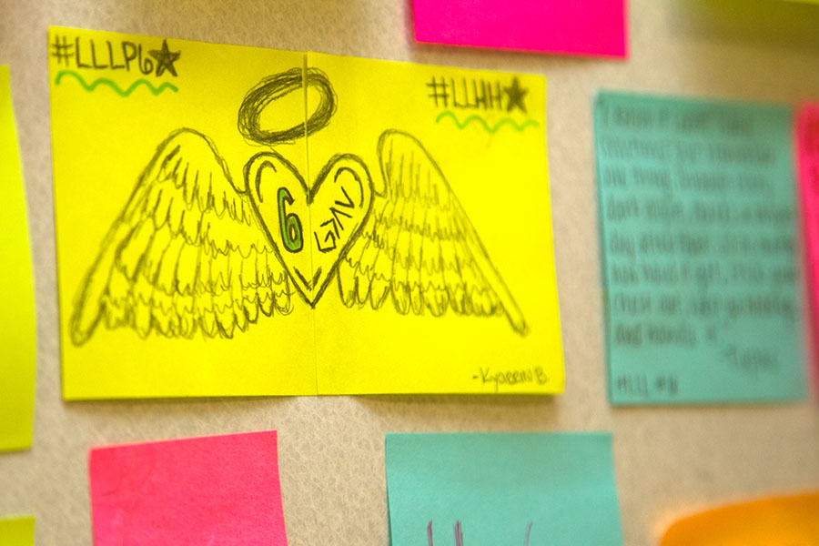 Positive Post-It Notes line the walls of the English hallway as a way to show support to the student body.