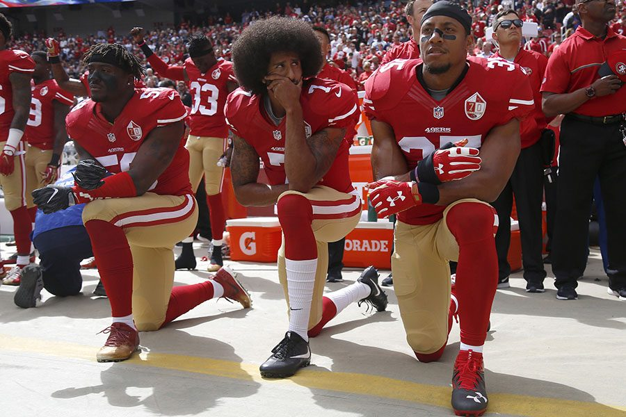 From left, San Francisco 49ers' Eli Harold (58), quarterback Colin Kaepernick (7) and Eric Reid (35) kneel during the national anthem before their NFL game against the Dallas Cowboys on Sunday, Oct. 2, 2016 in Santa Clara, Calif. (Nhat V. Meyer/Bay Area News Group/TNS)