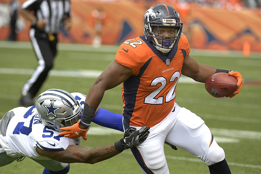 Dallas Cowboys outside linebacker Damien Wilson (57) bring down Denver Broncos running back C.J. Anderson (22) during the first quarter on Sunday, Sept. 17, 2017 at Sports Authority Field at Mile High in Denver, Colo. (Max Faulkner/Fort Worth Star-Telegram/TNS)
