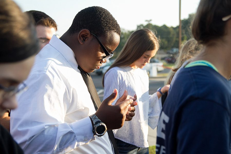 Students across the nation bow their heads in prayer at the See You at the Pole event.