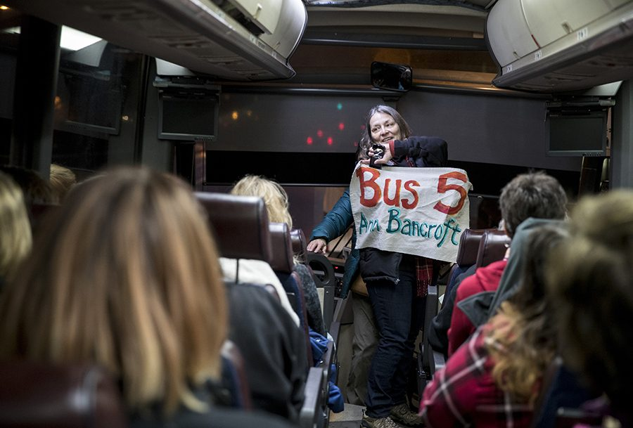 Deborah Capouch holds up the bus sign that included its name, Anne Bancroft, before it hit the road for the Woman's March on Washington early Friday morning, Jan. 20, 2016, in Minneapolis, Minn. The eight buses chartered from Minnesota were all named after prominent Minnesota women.  (Renee Jones Schneider/Minneapolis Star Tribune/TNS)