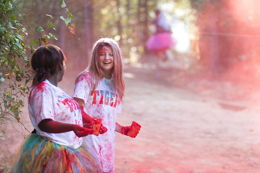 Seniors Jera Davis and Kamryn Hamilton ran last year's CASA Color Run.