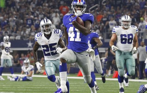 New York Giants cornerback Dominique Rodgers-Cromartie (41) runs for touchdown in the second quarter after a fumble by the Dallas Cowboys' Cole Beasley on Sunday, Sept. 13, 2015, at AT&T Stadium in Dallas. (Richard W. Rodriguez/Fort Worth Star-Telegram/TNS)