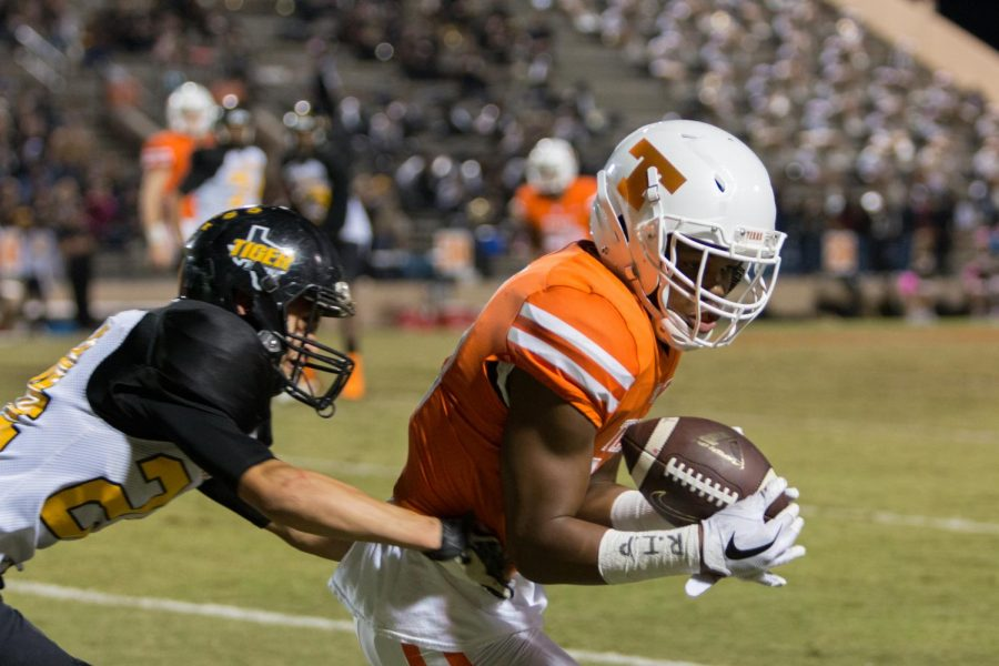 Kobe Webster advances the ball after the catch. The Tigers won with a score of 48-0.