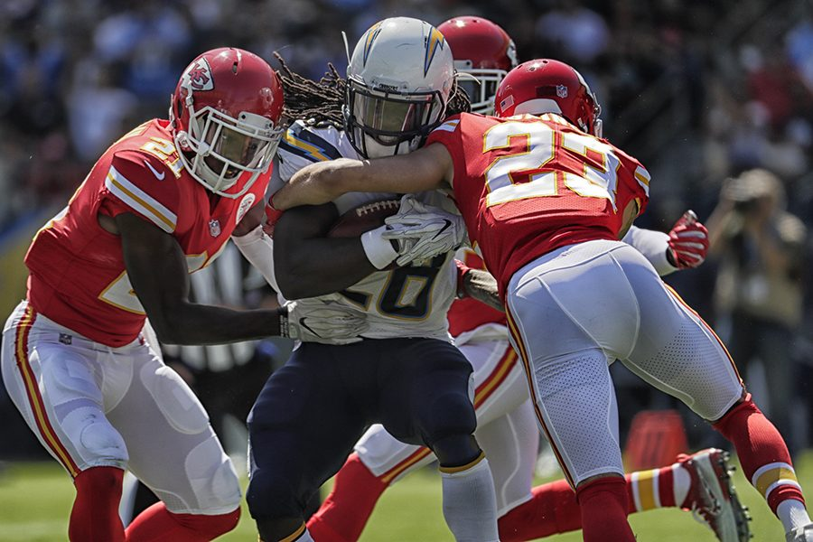 Los Angeles Chargers running back Melvin Gordon is wrestled to the ground by Kansas City Chiefs defenders during a first-half run at StubHub Center in Carson, Calif., on Sunday, Sept. 24, 2017. The Chiefs won, 24-10. (Robert Gauthier/Los Angeles Times/TNS)