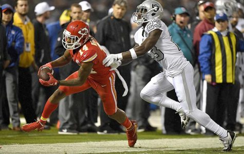 Kansas City Chiefs wide receiver Demarcus Robinson (14) picks up a first down in front of Oakland Raiders cornerback Dexter McDonald in the closing minutes of the second quarter at the Coliseum in Oakland, Calif., on Thursday, Oct. 19, 2017. (John Sleezer/Kansas City Star/TNS)
