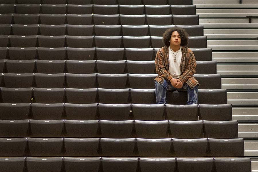 Keenan Thrapp sits alone on the bleachers in the Tiger Center to his feelings about mandatory pep rally attendance. Thrapp and other students that suffer from social anxiety no longer have a place to go during pep rallies.