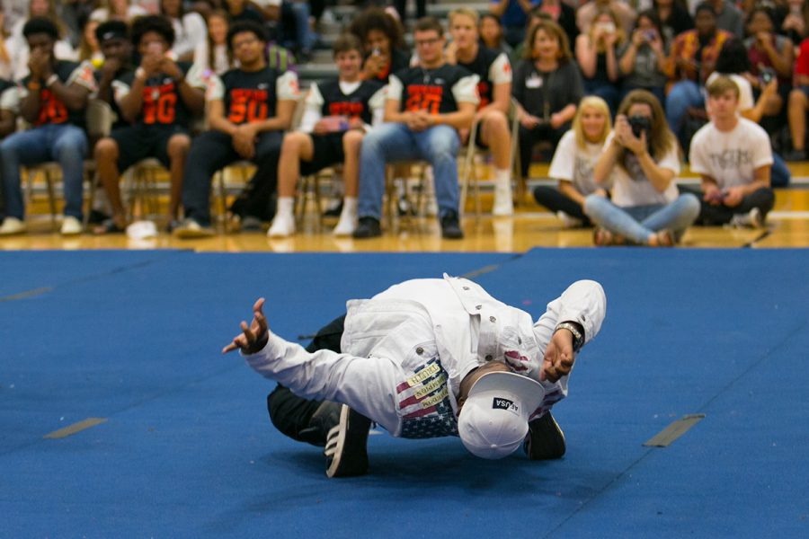Astounding the audience, freshman Jurman Williams smoothly drops his body to the music during a pep rally.