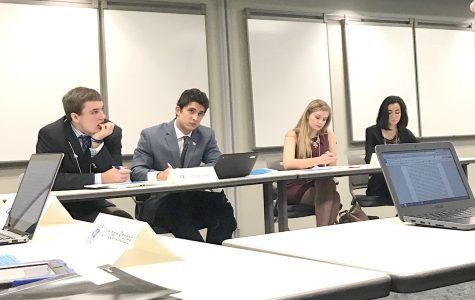 Sophomore Addison Cross and junior Hannah Klein quickly write a joint-resolution to resolve the Cyber Terrorism issue in the Security Council Committee. Submitted photo