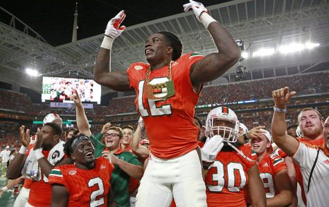 Miami Hurricanes defensive back Malek Young (12) wears the turnover chain after an interception in the second quarter against Notre Dame on November 11, 2017, at Hard Rock Stadium in Miami Gardens, Fla. (Al Diaz/Miami Herald/TNS)
