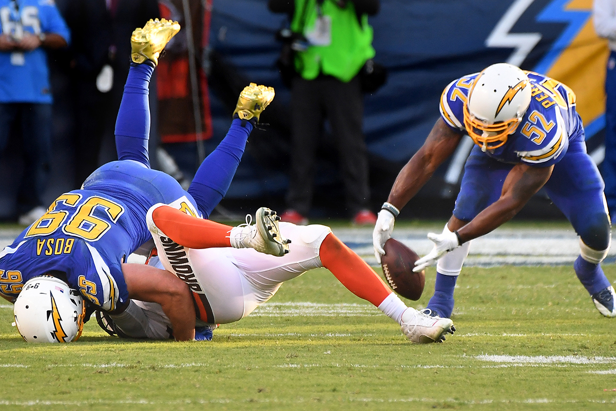 Los Angeles Chargers defensive end Joey Bosa sacks and forces a fumble on Cleveland Browns quarterback DeShone Kizer as Denzel Perryman recovers the ball in the fourth quarter on Sunday, Dec. 3, 2017 at the StubHub Center in Carson, Calif. (Wally Skalij/Los Angeles Times)