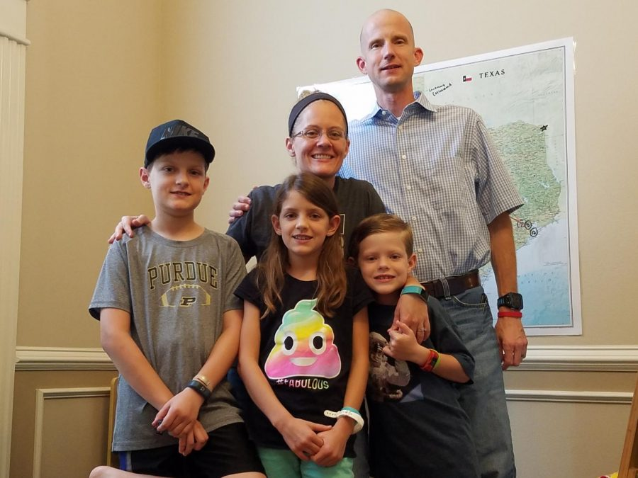 Algebra II teacher Nicole Ayers stands with her husband, Brandon, and children, Christopher, 11, Katherine, 9, and Daniel, 8. During the summer, the family competed in Brain Chase, an academic treasure hunt. The family won the competition, which included a $10,000 prize. submitted photo