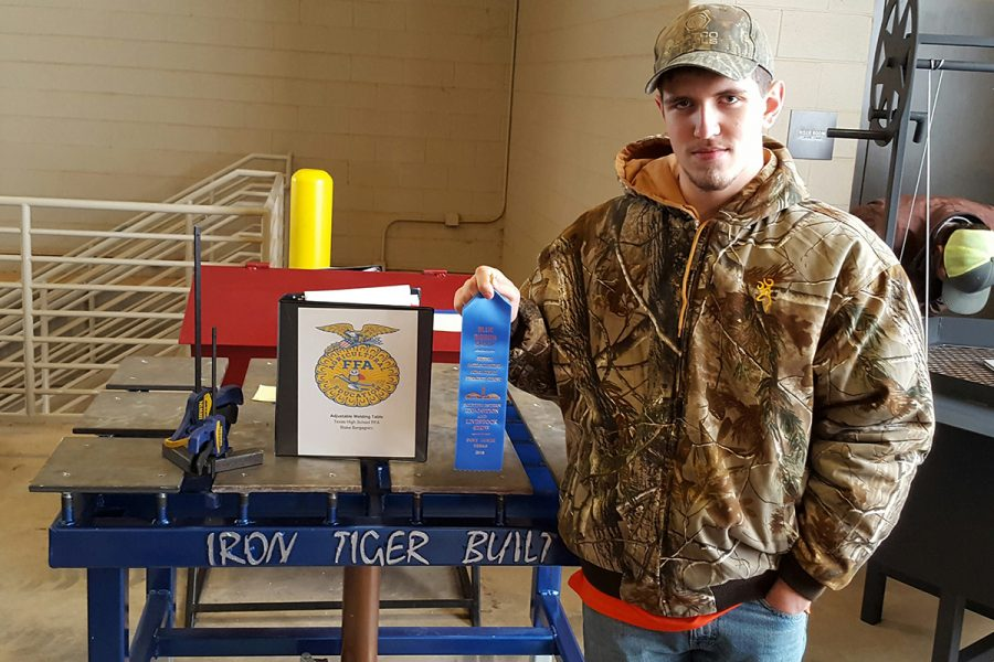 Sophomore Blake Berganini holds a blue ribbon that he won at an FFA competition. The next meet will be on Feb. 8 in San Antonio. Submitted photo