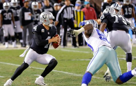 Oakland Raiders quarterback Derek Carr (4) passes under pressure from Dallas Cowboys defensive end Demarcus Lawrence (90) on Sunday, Dec. 17, 2017 at Oakland-Alameda County Coliseum in Oakland, Calif. (Rodger Mallison/Fort Worth Star-Telegram/TNS)