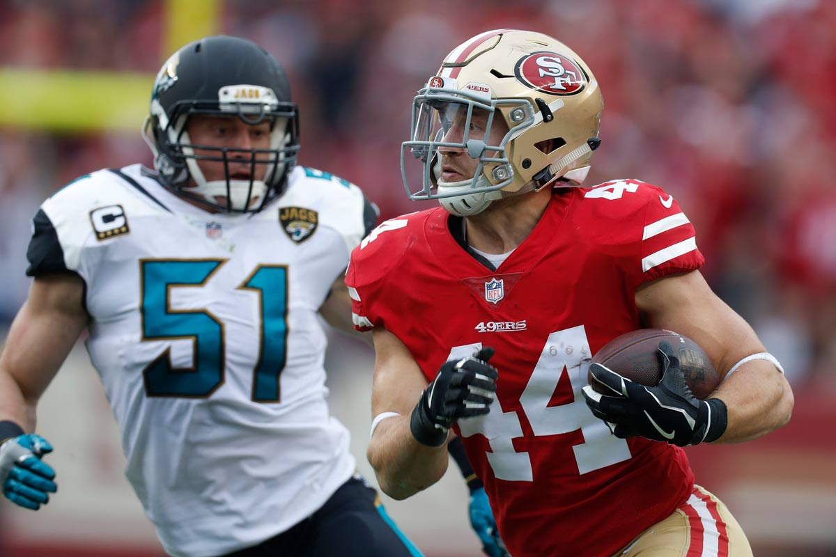 San Francisco 49ers' Kyle Juszczyk (44) runs after a pass against Jacksonville Jaguars' Paul Posluszny (51) in the second quarter of their NFL game at Levi's Stadium Sunday, Dec. 24, 2017 in Santa Clara, Calif. (Nhat V. Meyer/Bay Area News Group/TNS)
