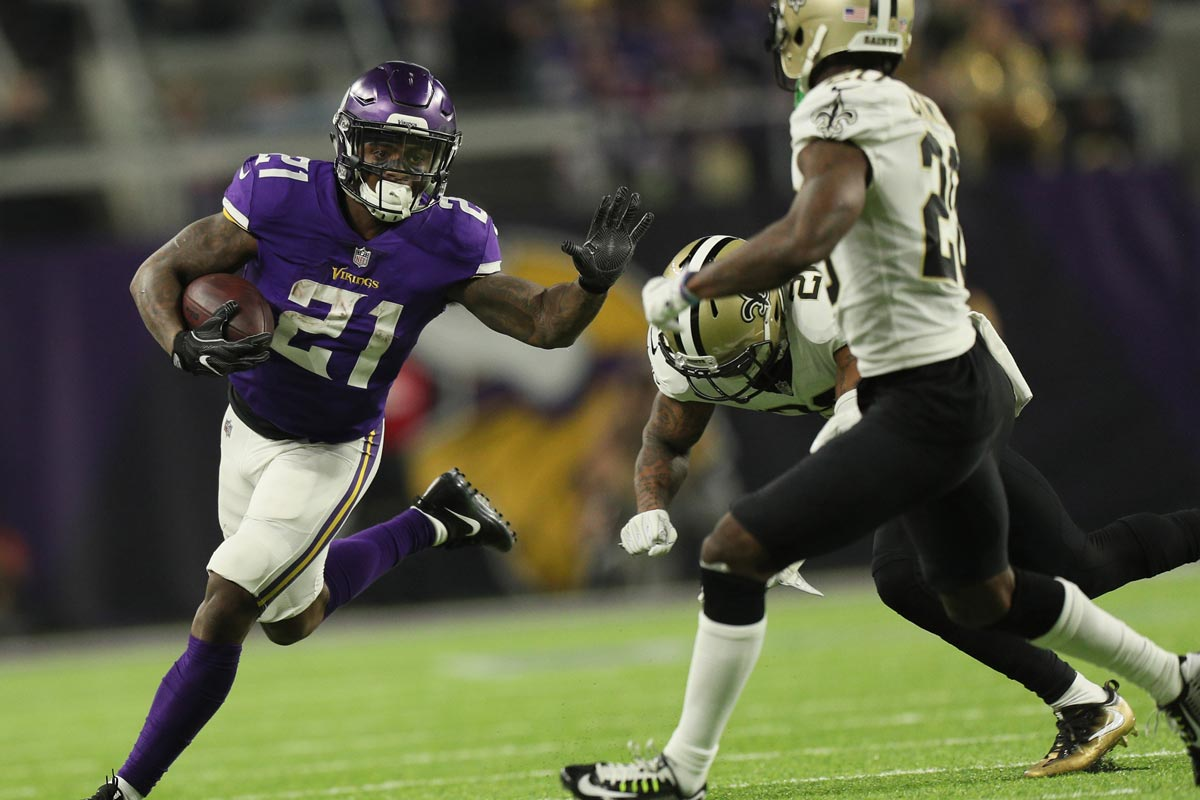 Minnesota Vikings running back Jerick McKinnon tries to avoid New Orleans Saints cornerback Ken Crawley (20) during the NFC divisional playoff game on Sunday, January 14, 2018 at U.S. Bank Stadium in Minneapolis, Minn. (Brian Peterson/Minneapolis Star Tribune/TNS)