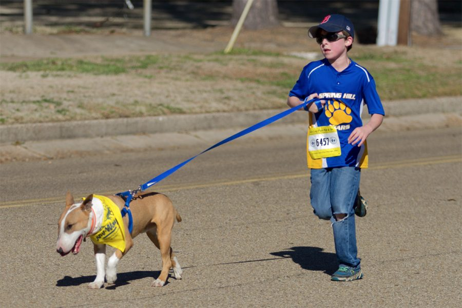 A+contestant+runs+with+his+dog+during+the+annual+Six+Leg+Fun+Run+and+5K.+This+event+was+held+on+Jan.+28%2C+and+was+intended+to+bring+in+donations+for+the+local+animal+shelters.