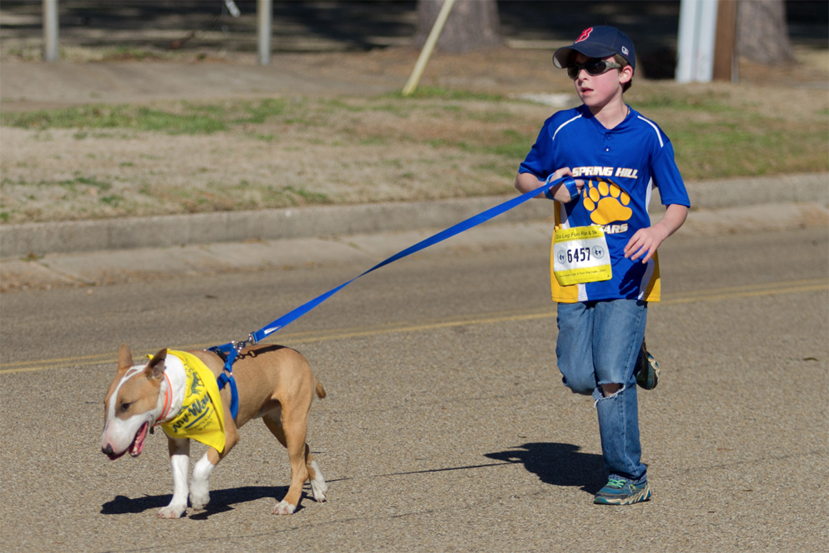 A contestant runs with his dog during the annual Six Leg Fun Run and 5K. This event was held on Jan. 28, and was intended to bring in donations for the local animal shelters.
