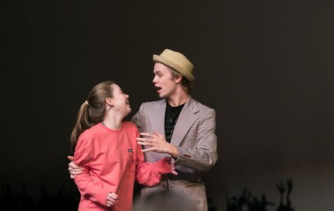 Senior Colton Johnson and freshman Cate Rounds sing together during