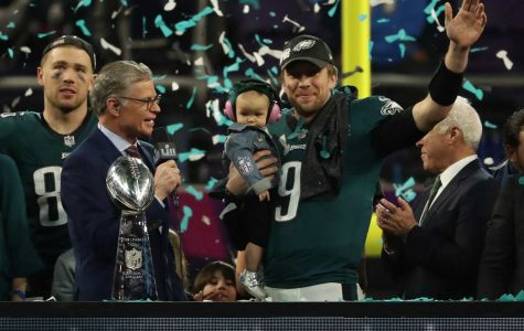 Philadelphia Eagles quarterback Nick Foles (9) holds his son and waves during the victory celebration after Super Bowl LII on Sunday, Feb. 4, 2018, in Minneapolis, Minn. (Jeff Wheeler/Minneapolis Star Tribune/TNS)