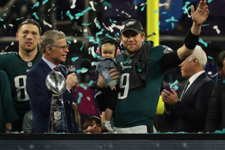 Philadelphia+Eagles+quarterback+Nick+Foles+%289%29+holds+his+son+and+waves+during+the+victory+celebration+after+Super+Bowl+LII+on+Sunday%2C+Feb.+4%2C+2018%2C+in+Minneapolis%2C+Minn.+%28Jeff+Wheeler%2FMinneapolis+Star+Tribune%2FTNS%29