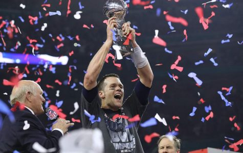 Tom Brady hoists the Lombardi Trophy, winning his fifth Super Bowl title, as the New England Patriots beat the Atlanta Falcons 34-28 in Super Bowl LI on Sunday, Feb. 5, 2017 at NRG Stadium in Houston, Texas. (Curtis Compton/Atlanta Journal-Constitution/TNS)