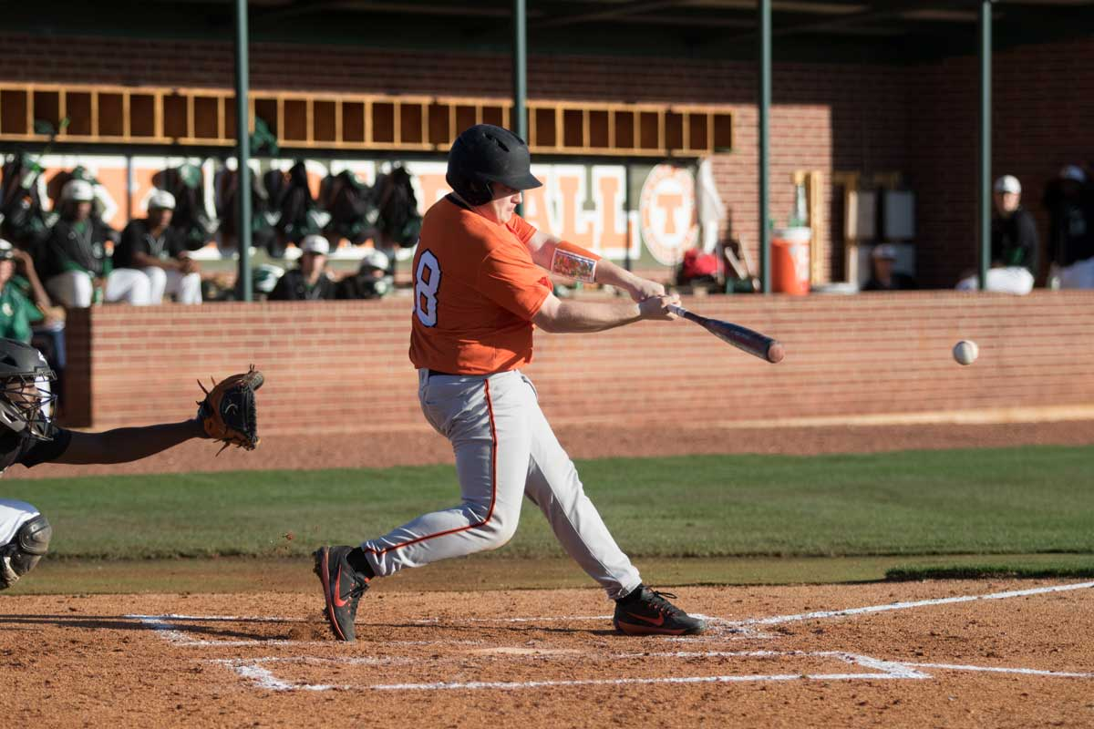 Senior Dakota Turner scorches a single base hit at their double header against Longview. Varsity baseball won both of these games on Monday, February 26, 2018.
