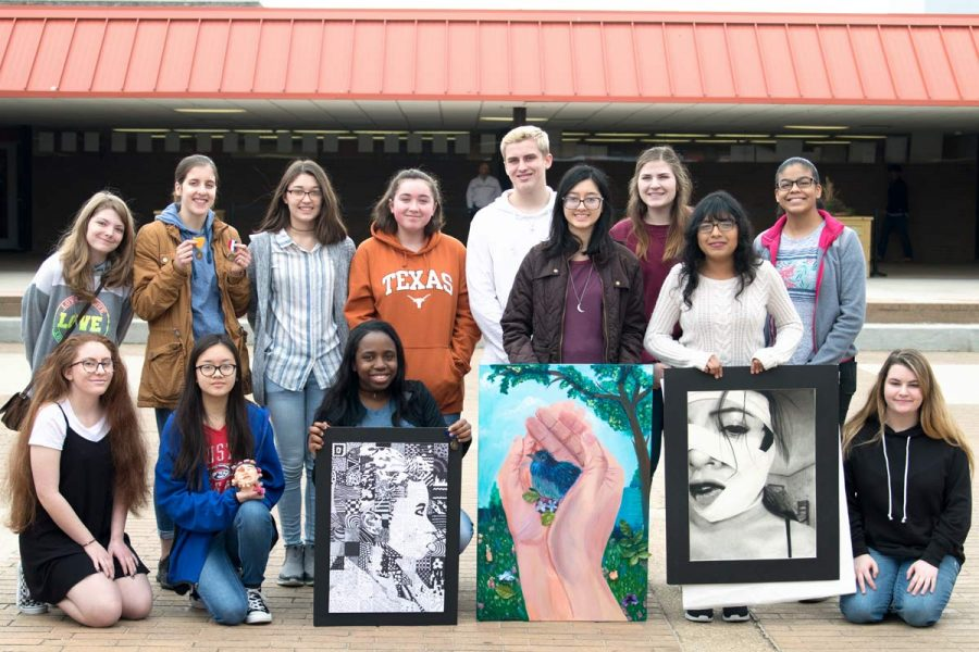 Art+students+pose+with+awards+earned+and+their+creations+from+the+Visual+Arts+Scholastic+Event+or+V.A.S.E.++These+student+competed+with+other+art+students+from+region+at+Pleasant+Grove+High+School+this+past+weekend.