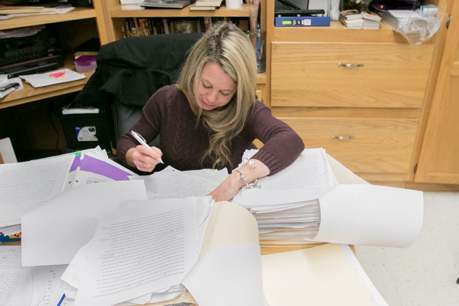 English teacher Michele Rigdon works on grading papers. She teaches multiple English classes and is dedicated to the success of her students.