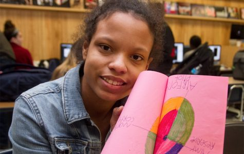 Holding her own crafted thank-you card, sophomore Sophia Conkleton shows her creativity and thoughtfulness. She has been sending these cards to many branches of the military for months.